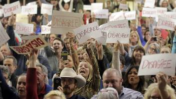 "Raucous protestors hold up ""Disagree"" signs at Jason Chaffetz's rally in his district (foxnews.com)"