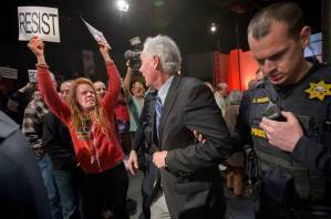 Rep. Tom McClintock of California's fourth district is escorted out of a town hall be police (Randall Benton/The Sacramento Bee/AP)